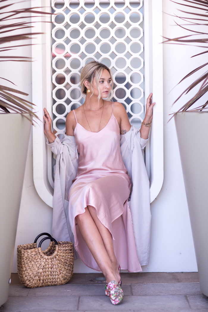 e03d67dea1f7 Something simple I ve been wearing this week is this delicate silky slip  dress. A light jacket and layered gold accessories take the slip into the  long ...